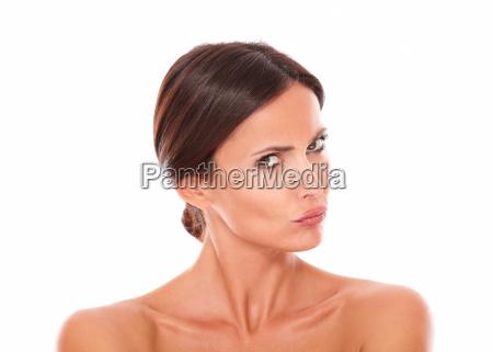 unsmiling hispanic female looking at camera