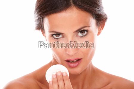 sensual latin woman applying make up