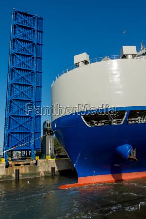 cargo ship before drawbridge