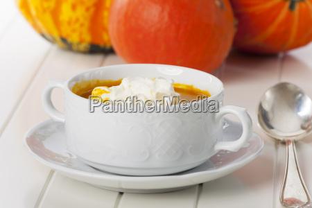 pumpkin soup on white background