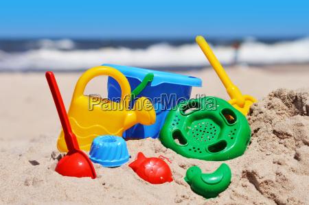 plastic children toys on the sand