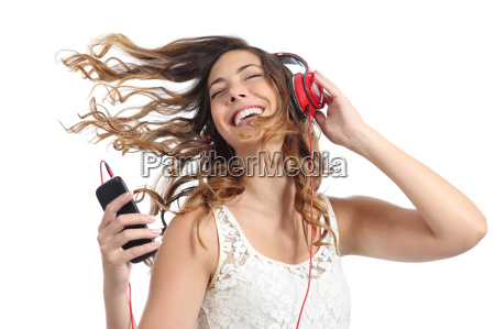 happy girl dancing and listening to