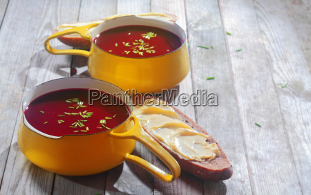 beetroot soups on bowls and bread