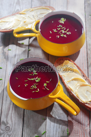 appetizing beetroot soup in yellow bowl