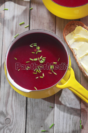 red violet beetroot soup in yellow