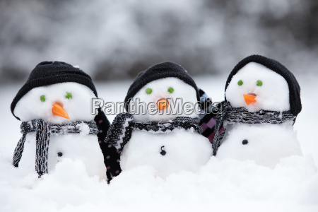 three little snowmen with hats