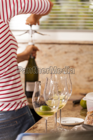 sparkling wine bottle with wine glasses