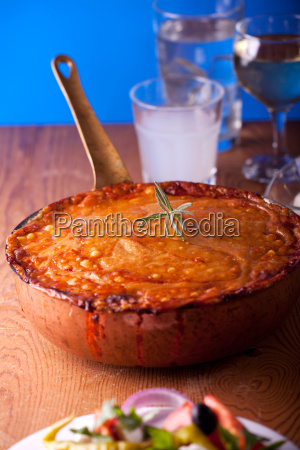 baked moussaka dish on a wooden