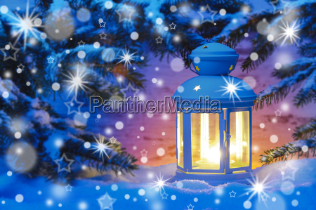 lantern with candle in snow