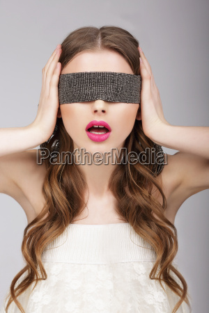 confusion woman holding headband on her