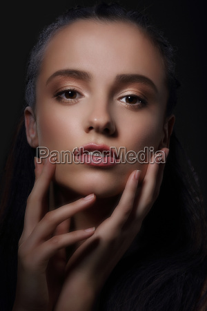 sentiment affectionate woman touching her face