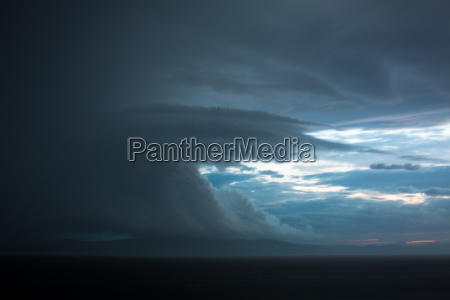 gathering storm clouds in a vast