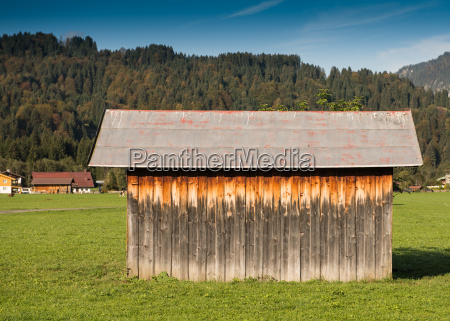 wooden hut with a roof of