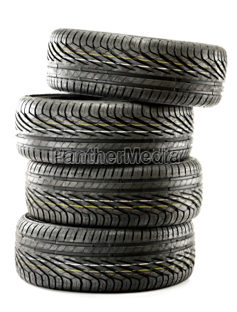 four new black tires isolated on