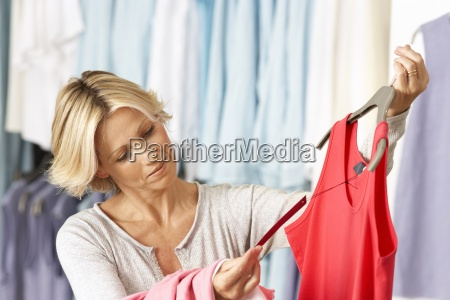 mature woman shopping in clothes shop