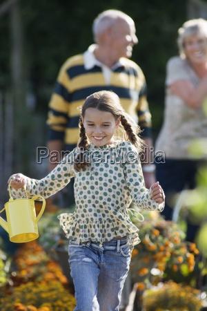 girl 8 10 running in garden