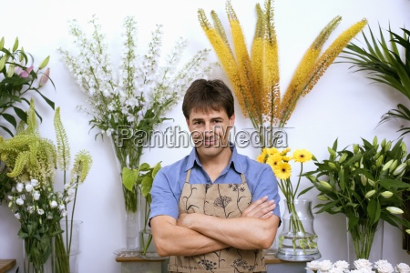 male florist in apron standing in