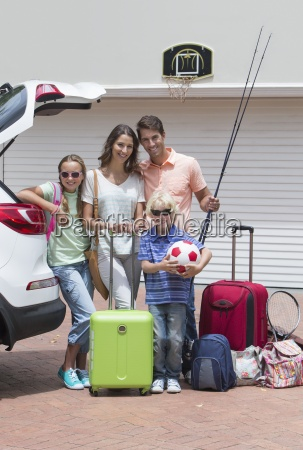portrait of smiling family packing car