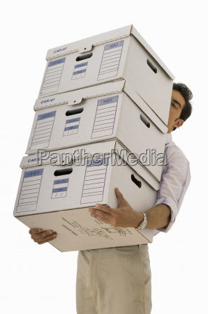 businessman carrying stacked file boxes face