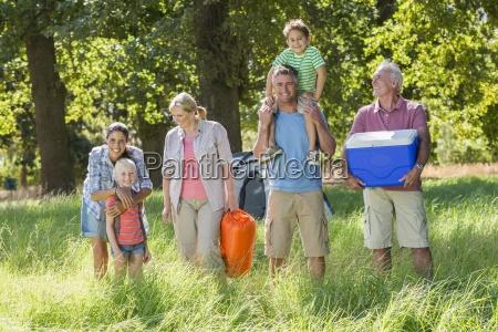 multi generation family enjoying camping in