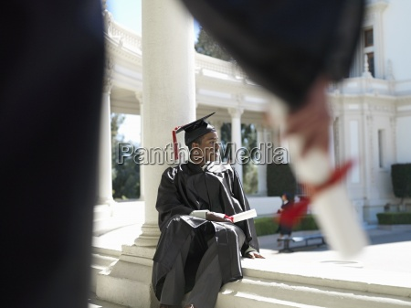 university student in graduation gown and