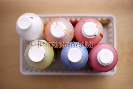 bottles of multi coloured paints close
