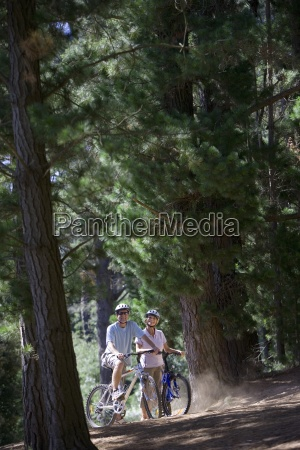 mature couple in mid distance mountain