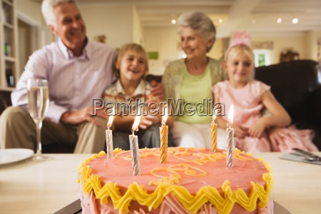 senior couple sitting with grandchildren 4