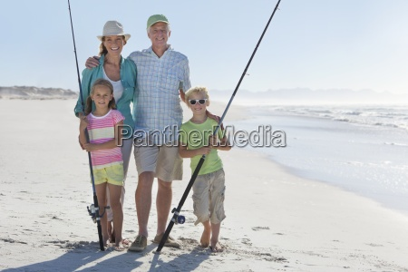 grandparents and grandchildren with fishing rods