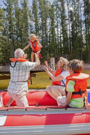 grandparents and grandchildren enjoying boat trip