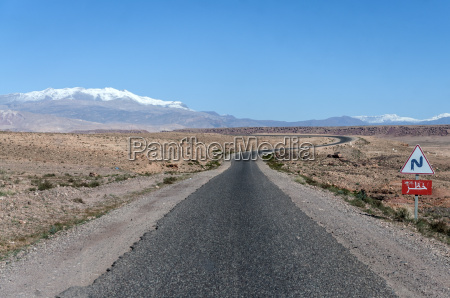 road through snow covered atlas mountains