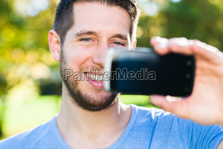 young man with smart phone in