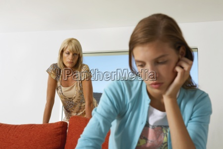 girl upset mother in the background