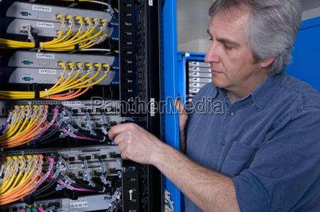 it technician working on network server