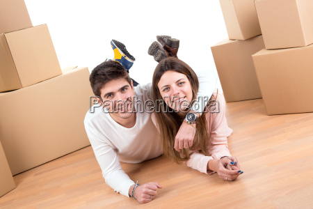 happy, couple, with, boxes - 12756760