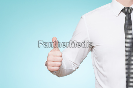man with shirt and tie thumbs