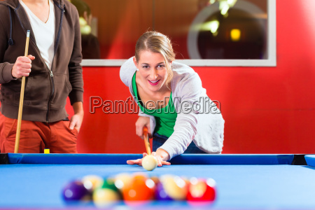 couple playing snooker