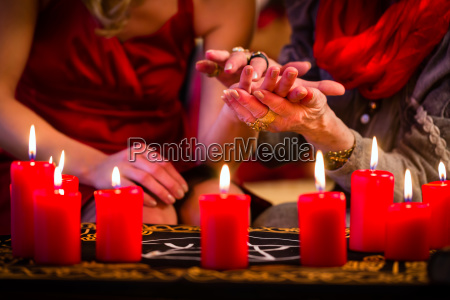 hellseherin during a seance in palmistry