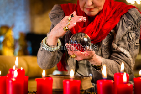 hellseherin during seance with glass ball