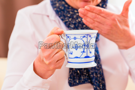 senior drinking tea and cured their