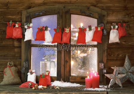christmas sacks candles and stars at