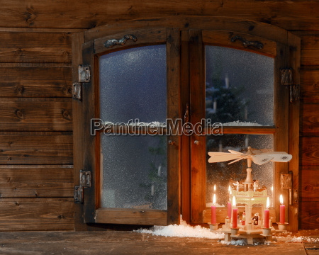 lighted red candles on stand at