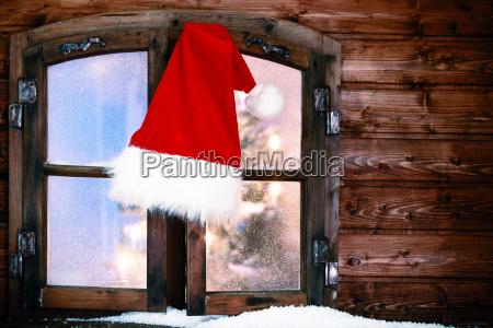 santa hat hanging at rustic window
