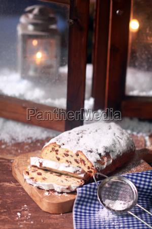 sliced christmas bread on wooden board