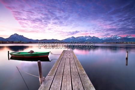rowing boat on alpine lake