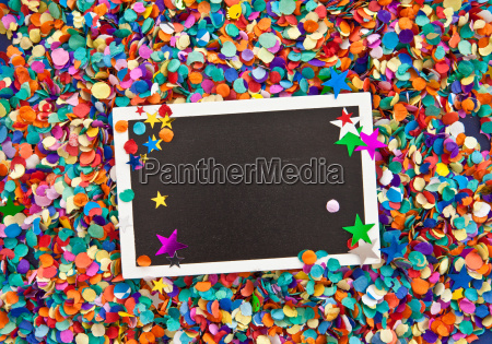small blackboard on confetti