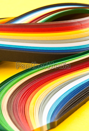 colorful paper strips on yellow