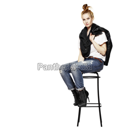 girl sitting on stool