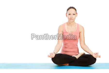 yoga pose padmasana against white background