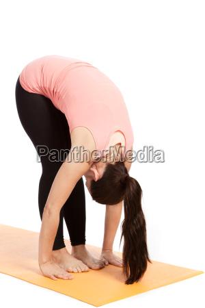 yoga exercise on the mat uttanasana